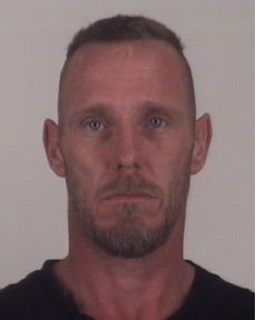 Police said they caught 41-year-old Darren Douglas Porter burglarizing the shop in the 800 block of South Cherry Lane at about 7:20 a.m. Friday.