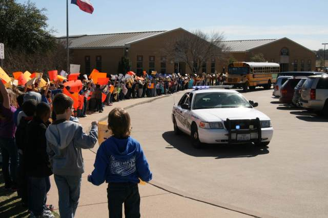 Students at Blue Haze Elementary cheer on the boys basketball team as they head to the playoff game.