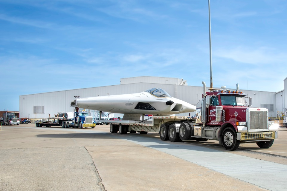 "White Settlement Police recently escorted the mockup of the A-12A Avenger Stealth Fighter through city streets and highways to its new home at the B-36 Peacemaker Museum near Meacham Airport. The plane, with nicknames like ""Dorito"" and ""UFO,"" was developed by General Dynamics in Fort Worth but never built. But thanks to some aviation friends, the mock-up of the A-12A Avenger Stealth Fighter is expected to emerge with a fresh coat of paint at the B-36 Peacemaker Museum near Meacham Airport. Photo by Angel Del Cueto"