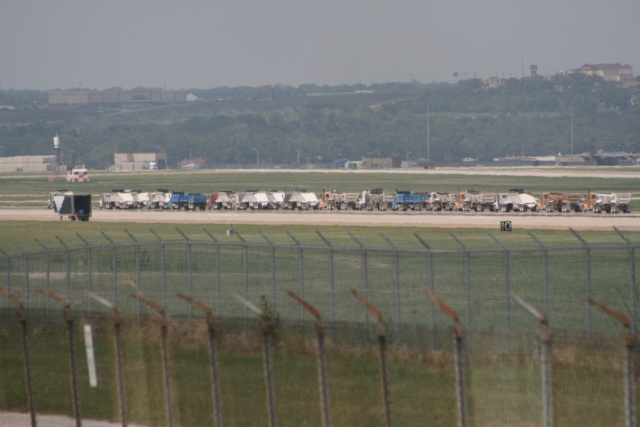 A long line of 18-wheelers hauled tons of pavement from Naval Air Station runway this week.