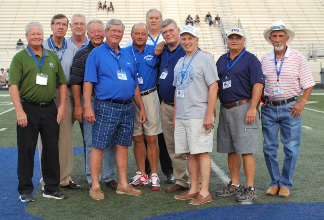 The inductees pause for a photo during the game at BHS.