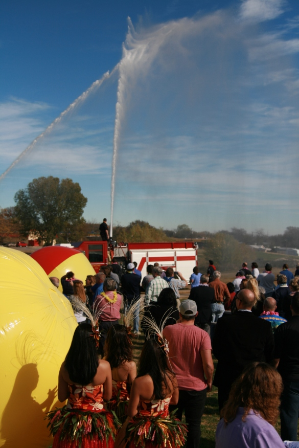 White Settlement Fire Trucks spray water in the are during the ceremony.