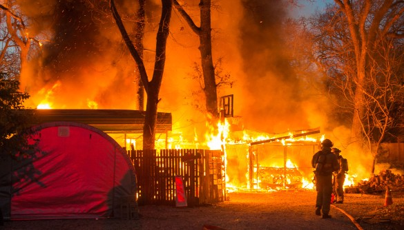 Firefighters battle a blaze in freezing temperatures.