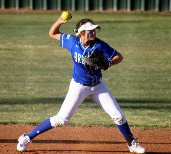 Destiny Chavarria makes a throw to first base.