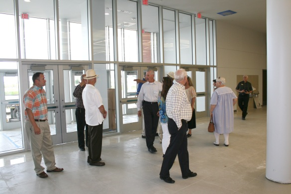 Chamber members are guided through the main entrance to the newly renovated building.