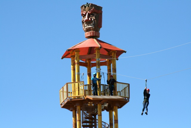 Hawaiian Falls Adventure Park employees test the new zip line from high atop the Tiki head perch. Photo by Ben Posey