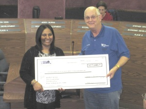 Patel's wife was on hand to receive a $275,000 check from the EDC.