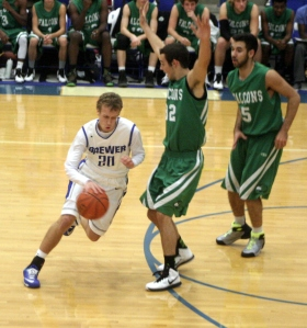 Alex Bagg dribbles around a defender.