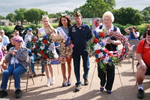 Kaitlyn Aryton, Miss White Settlement and Ady Forrester, Miss White Settlement Outstanding Teen along with members of the VFW Post placed wreaths at the base of the Veterans Park flag pole.