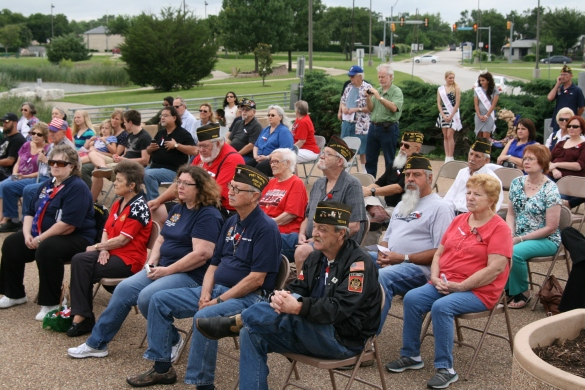 A crowd of people gathered for the ceremony at Veterans Park.