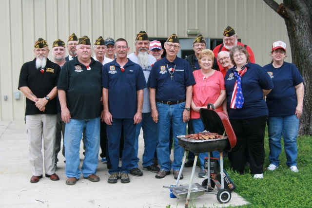Members of the VFW Post 5617 cook hotdogs after the ceremony at their location on Cherry Lane.