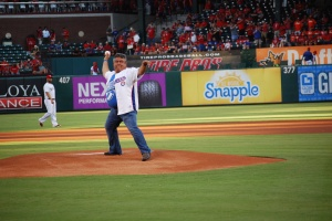 Superintendent Frank Molinar on the mound at the Texas Ranger game.