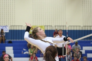 Laura Jenkins puts a kill shot on the Saginaw team.