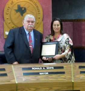 Mayor Ronald A. White accepted a presentation from Detective Sherry Alldredge of the Fort Worth Police Department.  Alldredge was acting on behalf of One Safe Place, an organization that assists those impacted by domestic violence.  She thanked the City of White Settlement for supporting the organization.