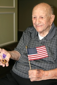 Bob received a purple heart while serving in the South Pacific. A bomb exploded and injured him while on the island of Ie Shima near Okinawa.