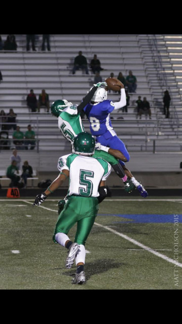 #8  Jeshaun Patton  makes a grab against Azle.