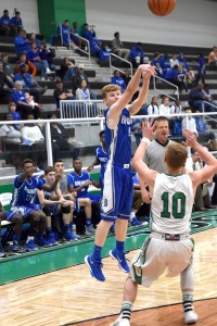 Brewer Bear #4 Joshua Burnett, Junior, hits a 3-pointer against the Azle Hornets earlier in the season. The Bears play Dunbar Tuesday night.