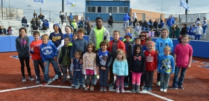 Kids ran the basis during the opening ceremonies of the new baseball and softball field turf.