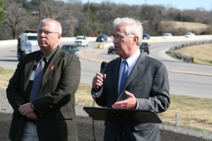 State Representative Charlie Geren and TxDOT Engineer Brian Barth address a crowd of citizens and reporters near the Lake Worth bridge on Jacksboro Highway.