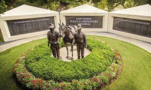 The Police and Firefighters Memorial features bronze sculptures of a firefighter, police officer and riderless horse. Adjacent to the sculptures are two walls of names that list all police officers, firefighters and marshals who have died in the line of duty.