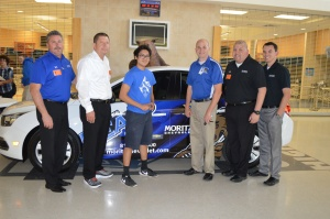 Pictured with Sablan are: Dick Titterington, Moritz Chevrolet general sales manager; Jim Hardick, general manager; Gabriel Lozano, sales manager; and Robert Sanders, sales.