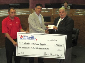 John Bitter, owner of Frontier Veterinary Hospital, accepts the Business Incentive grant check from EDC Director Kyle Reeves (left) and Mayor Ronald A. White (right).
