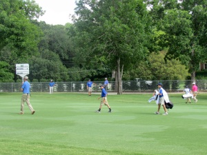 Javie Cerda (middle), and caddie Tre Wright (behind) from Benbrook Middle School walk down the fairway at Colonial.