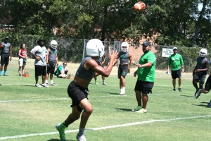 The Lake Worth Bullfrog football team works on passing drills.